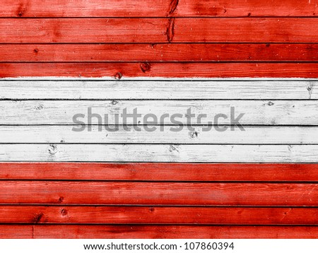 The Austrian flag painted on wooden fence - stock photo