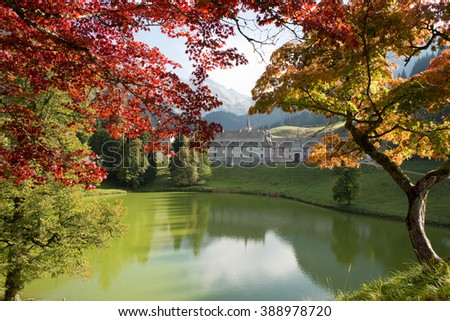 the autumn mountain landscape in the French Alps with monastery