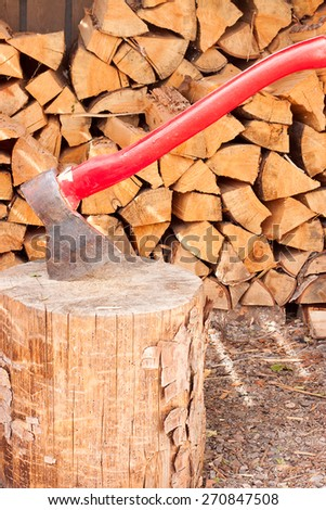 the axe and chopped a lot of firewood - stock photo