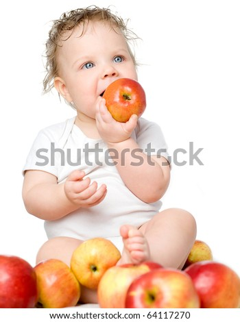 The babe, in an environment of red apples on a white background
