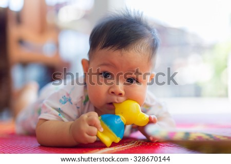 the baby bites rubber toy - stock photo