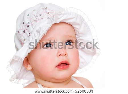 The baby  girl in a hat, isolated on the white
