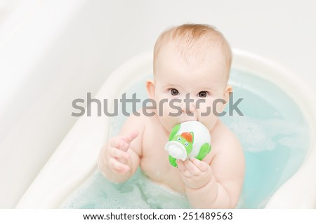 The baby is bathed in the tub