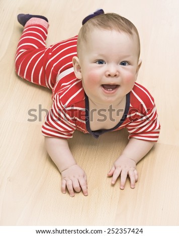 The baby is lying on the floor at home  - stock photo