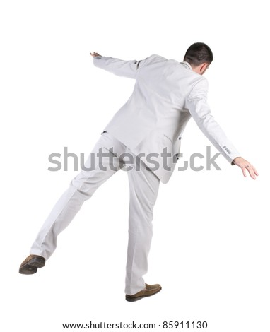 The back of balancing  businessman  . Rear view. Isolated over white background.