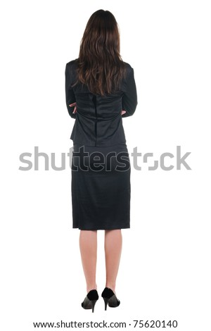The back of beautiful young woman looking at wall. Rear view. Isolated over white. - stock photo