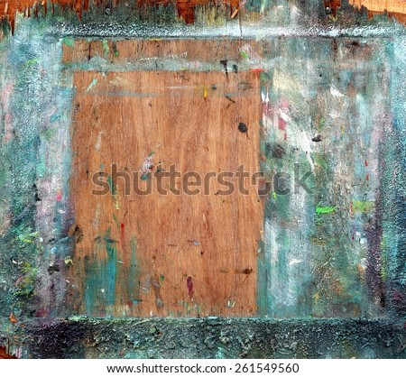 The backboard of an easel showing lots of use by a painter  - stock photo