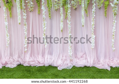 The backdrop in the wedding ceremony with the grass and flower. - stock photo