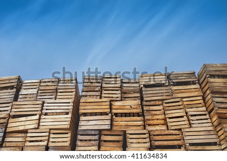 the background a lot of boxes on pallets. against the blue sky sky - stock photo