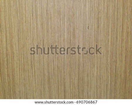 The background and texture are brown wood.