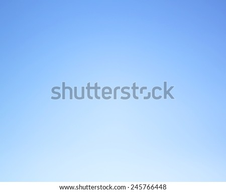The background color of the sky before sunset blue. Empty sky. - stock photo