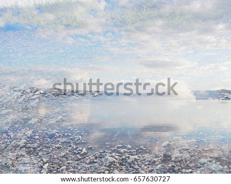 The background from the image made at the lake at sunset. The complex mixed image of the clouds and the water surface. The image for the decoration of a modern smart home.