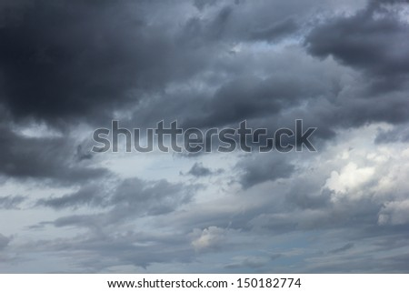 the background image of the storm cloud on the sky - stock photo