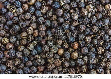 The background of black peppercorns