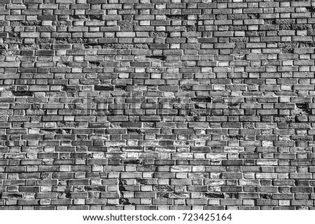 The background of the gray old brick wall. Architectural element - a dark design of the structure. The texture of the ceiling.