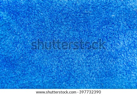 The background, texture of bright blue artificial wool - stock photo