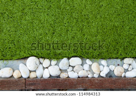 The background with grass , stone and wood.