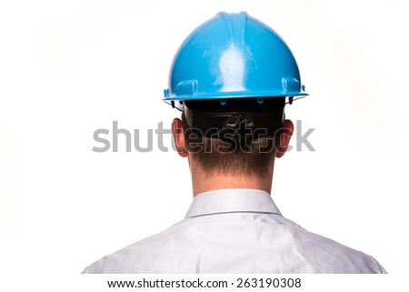 The backside of a business man with a safety helmet isolated on a white background - stock photo