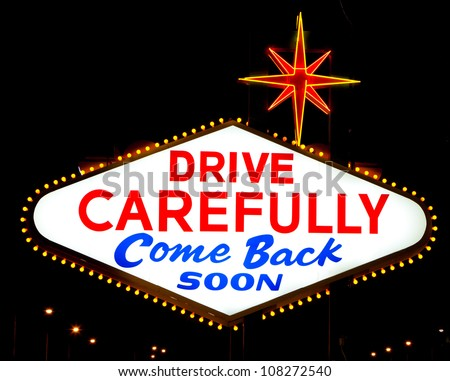 """The backside of the famous Las Vegas sign reading """"drive carefully, come back soon"""" - stock photo"""