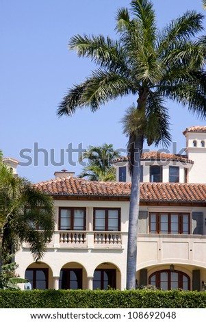 The backyard of a luxury home in Florida as seen from the water. - stock photo