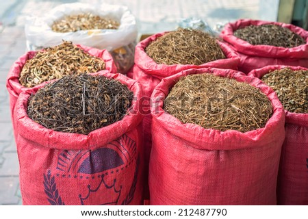 The bags of herbs used as medicine at market, Hochiminh city, Vietnam - stock photo