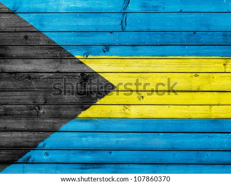 The Bahamas flag painted on wooden fence - stock photo