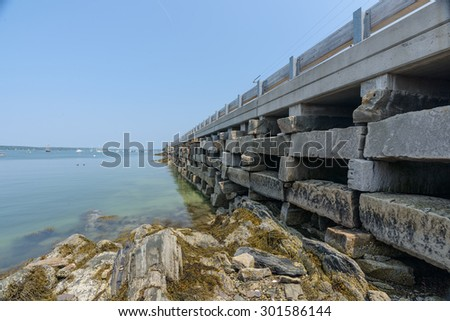 The Bailey to Orr Island cribstone style bridge is the only one of it's kind in the world connecting Bailey and Orr Island in Maine over Will's Gut inlet.  It was built to accommodate the strong tides - stock photo