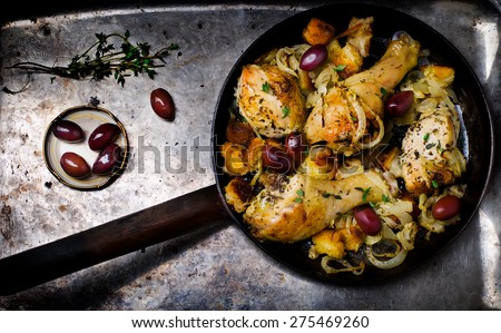 the baked chicken on a frying pan the top view. style vintage. selective focus - stock photo