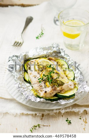 the baked cod with zucchini .selective focus