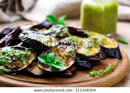 the baked eggplants with green herb  sauce. top view. selective focus - stock photo