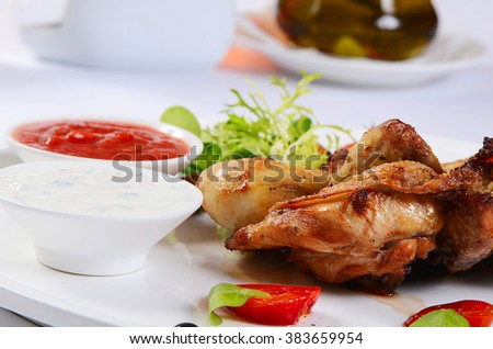 The baked hen with salad close up - stock photo