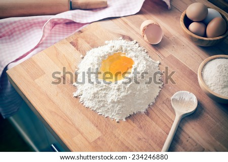 the baking ingredients on wooden board - stock photo
