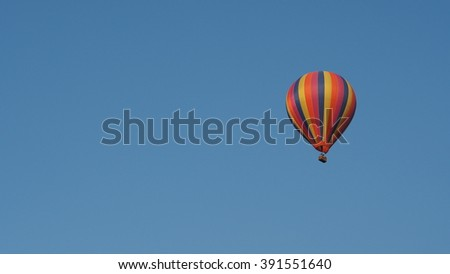 the balloon is rising up into sky