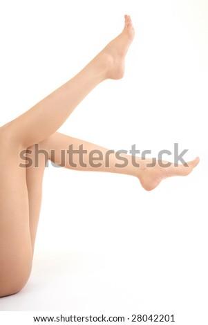 The barefooted female feet lifted upwards sideways, isolated - stock photo