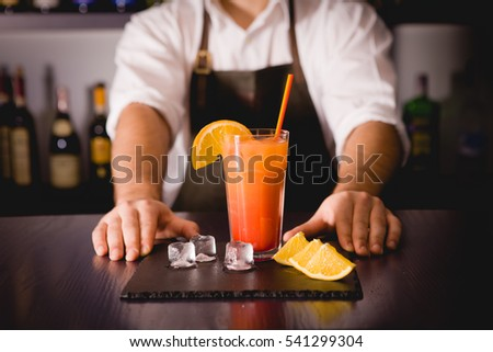 The bartender at the bar restaurant or pub to making a cocktail on the holiday table. Space for text. Cocktail Recipe