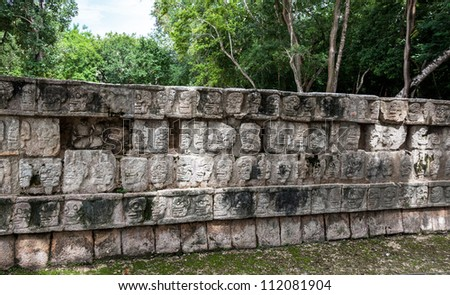 The bas-relief with skulls on the wall in Chichen Itza - Yucatan, Mexico