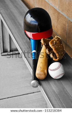 The baseball equipment is in the dugout ready to go. - stock photo