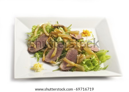 The basic dish from a fried potato and ham slices on a light plate a shot horizontal - stock photo