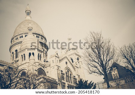 The Basilica of the Sacred Heart of Jesus on Montmartre in Paris, France, vintage style - stock photo