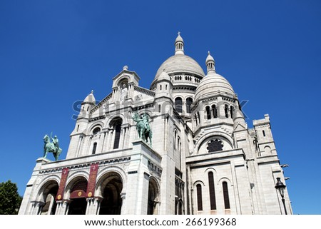 The Basilica of the Sacred Heart of Paris, Sacre Coeur Basilica, located on Montmartre, the highest point in Paris, France. - stock photo