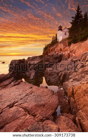 The Bass Harbor Head Lighthouse in Acadia National Park, Maine, USA. Photographed during a spectacular sunset. - stock photo