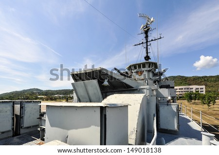The battleship in the garden and blue sky - stock photo