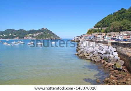 The bay in San Sebastian seen from the beach promenade on a sunny day - stock photo