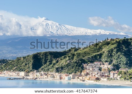 The bay of Giardini-Naxos with the snowy Mount Etna in the background. Winter view from Taormina. Province of Messina. Sicily, Italy. - stock photo