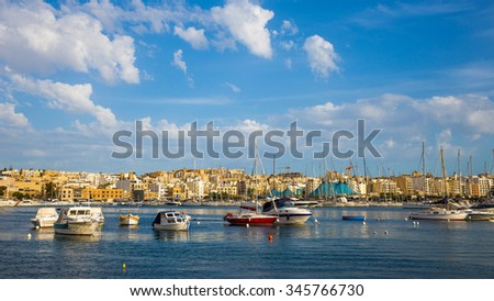 The bay of Valletta with sailing boats and ships - Malta - stock photo