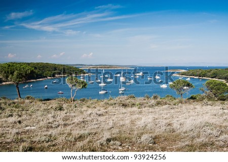 the bay with boats in Kamenjak - near Premantura, 13 km by Pula - stock photo