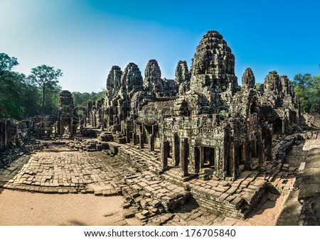 The Bayon Temple is one of the most significant historical and religious sites in the Angkor Thom area. The ruins feature over one hundred huge faces carved into the towers. - stock photo