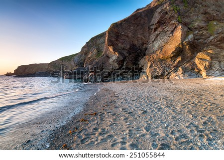 The beach and cliffs at Polpeor Cove on Lizard Point in Cornwall, the most southerly tip in Britain - stock photo