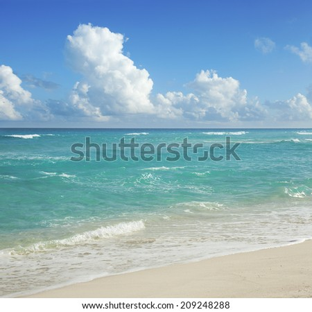 The beach and clouds on a sunny day in Cancun, Mexico - stock photo