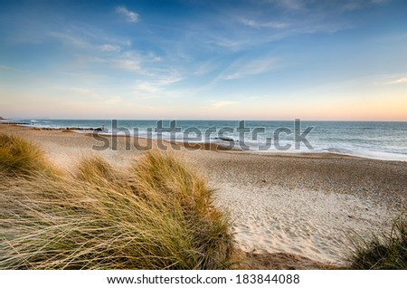 The beach and sand dunes at Hengistbury Head near Bournemouth in Dorset  - stock photo
